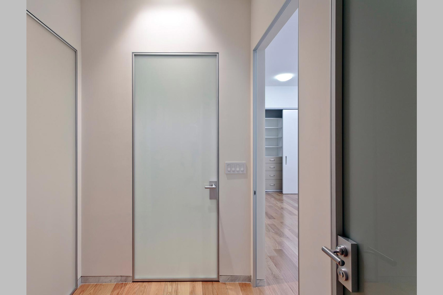 Glass doors give the loft a clean contemporary design.
