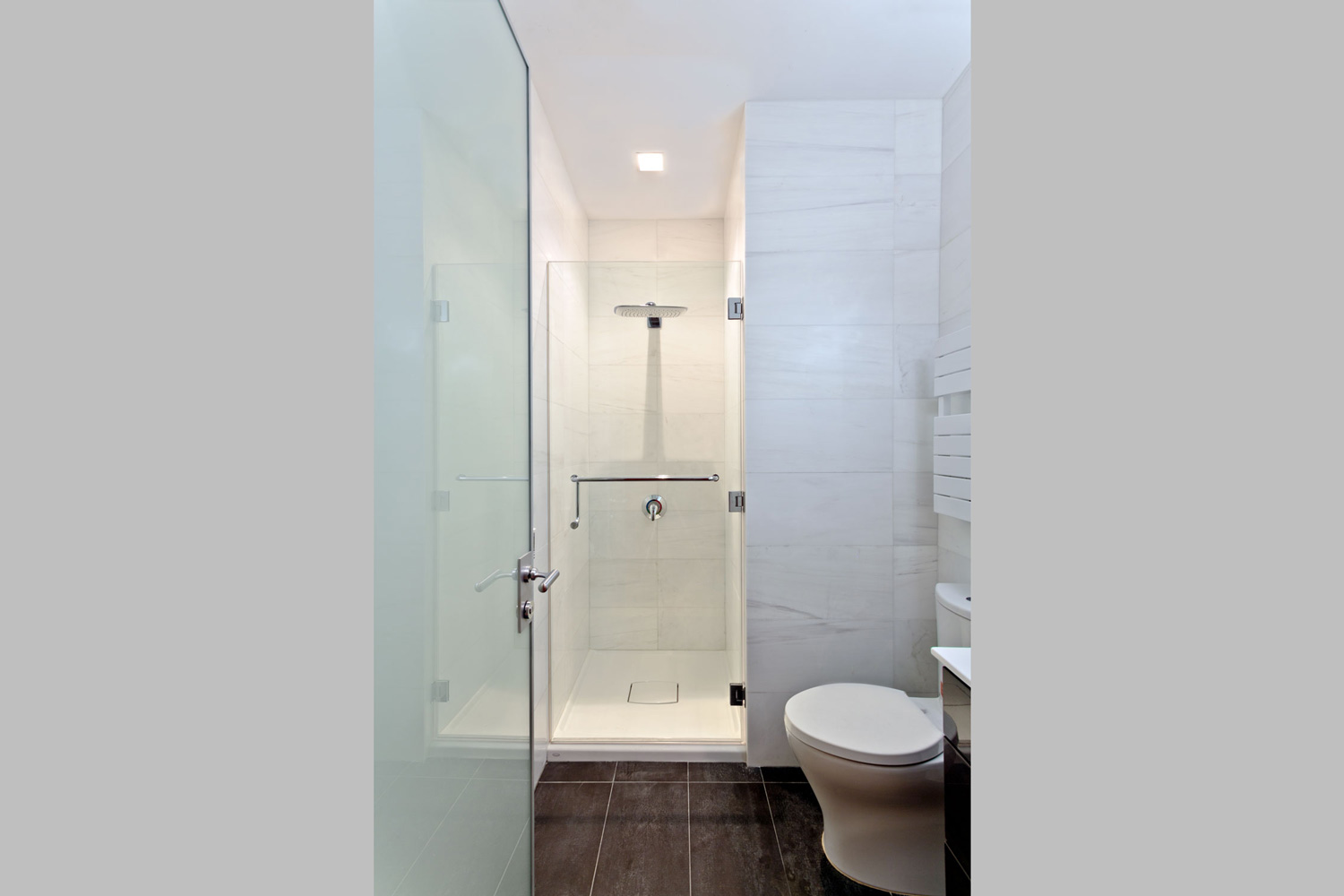 Modern bathrooms incorporate warmth with radiant heated floors, natural sand stone and heated towel warmers.