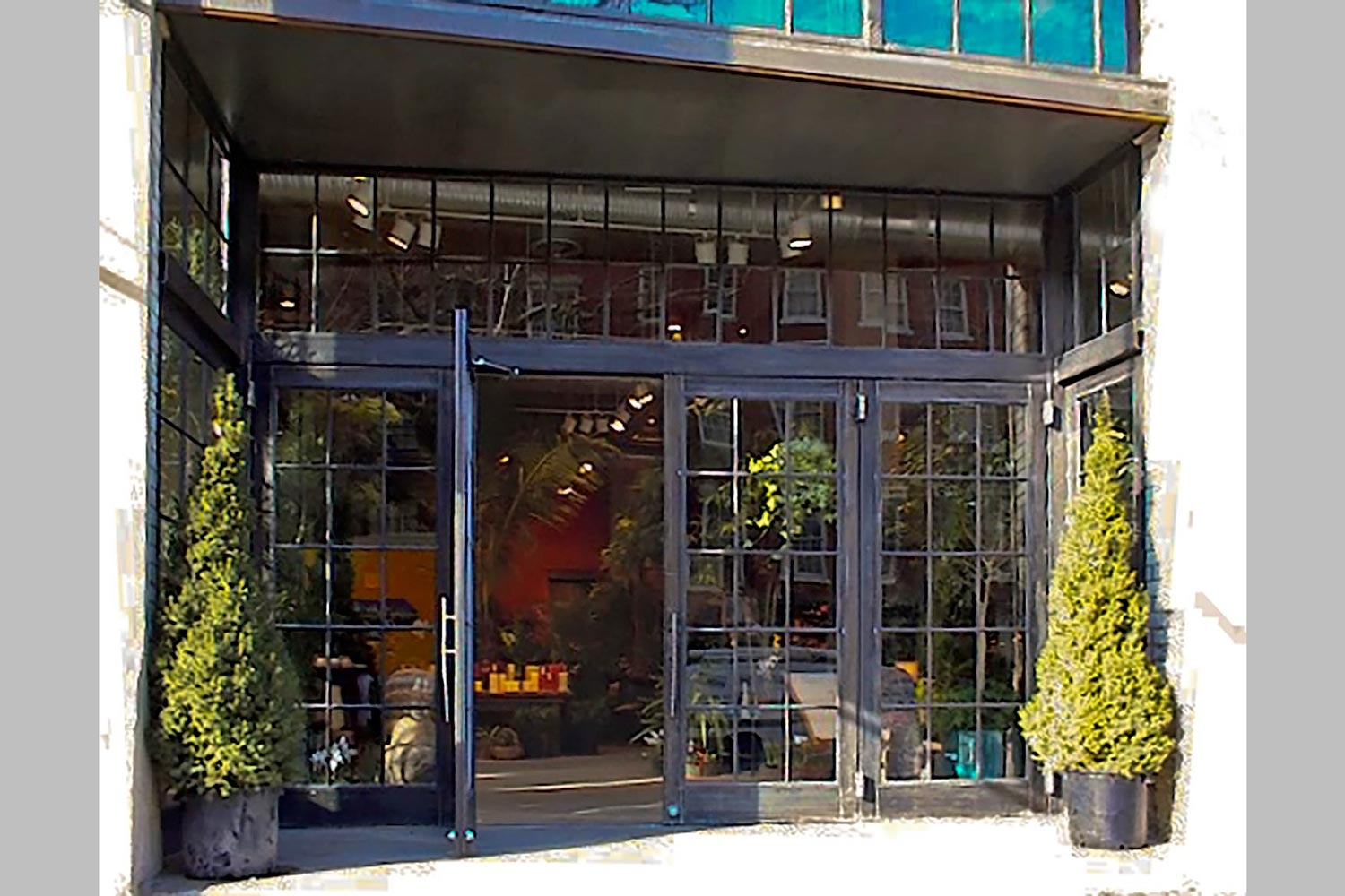 OCV introduced a custom steel and glass facade to dissolve the storefront threshold.
