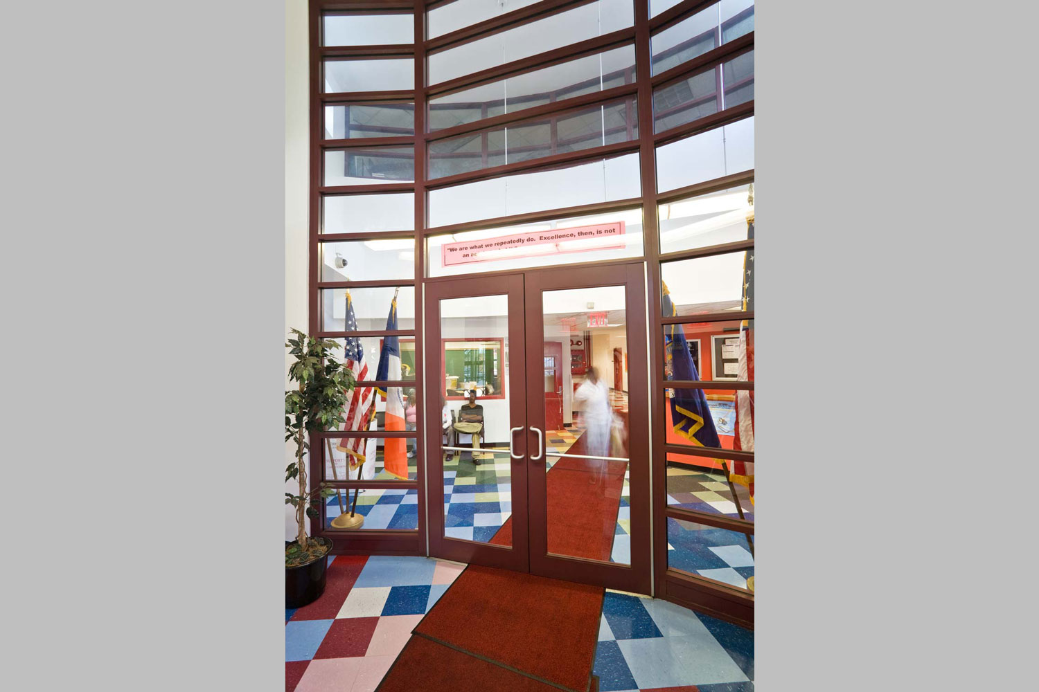 The foyer with security desk at the Acorn High School for Social Justice. Project by OCV Architects.