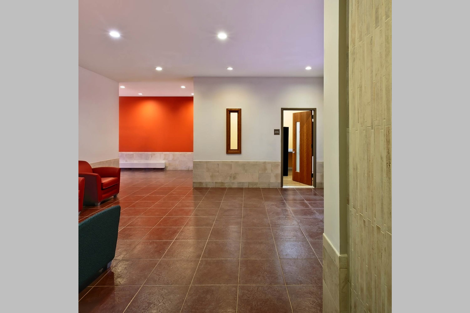 The first floor elevator lobby offers residents lounging and access to an interior courtyard.