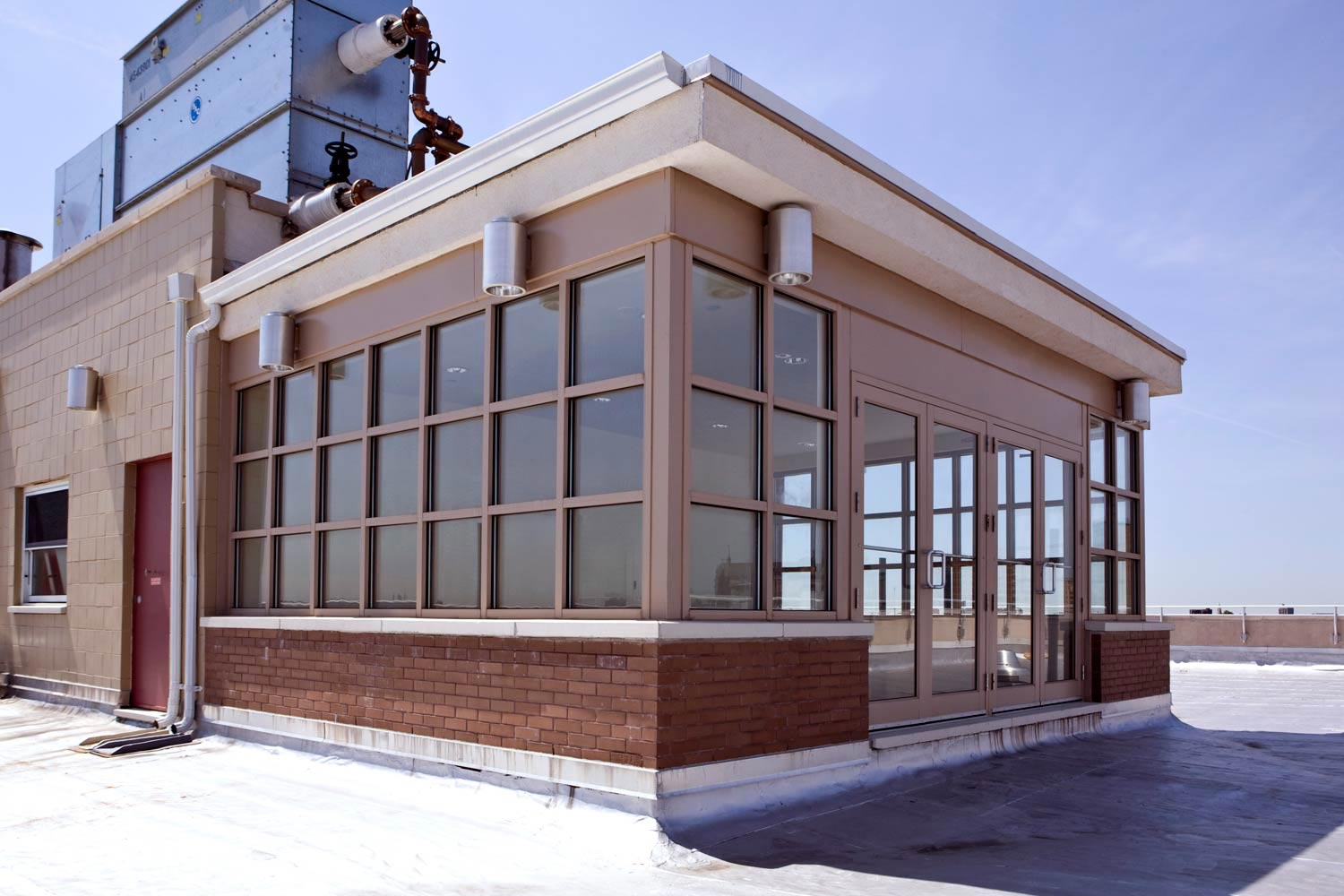 A glass enclosed rooftop community room tops off the new construction addition.