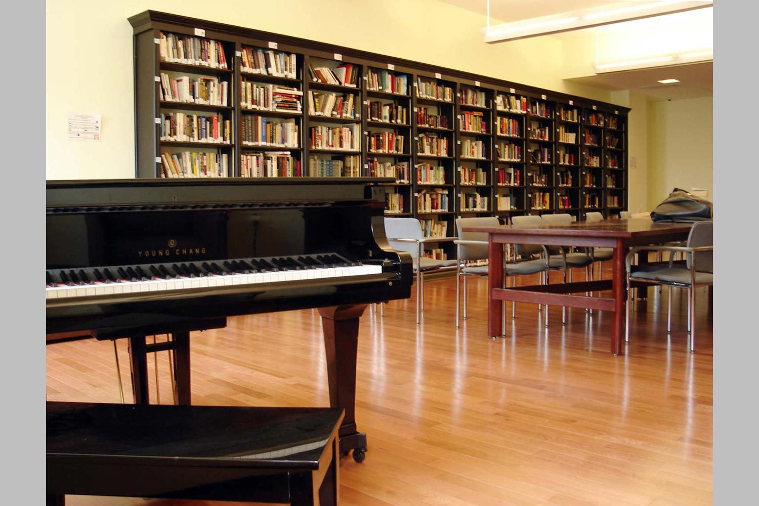 A library with a reading area and grand piano were incorporated into the Cornerstone Residence rehabilitation.