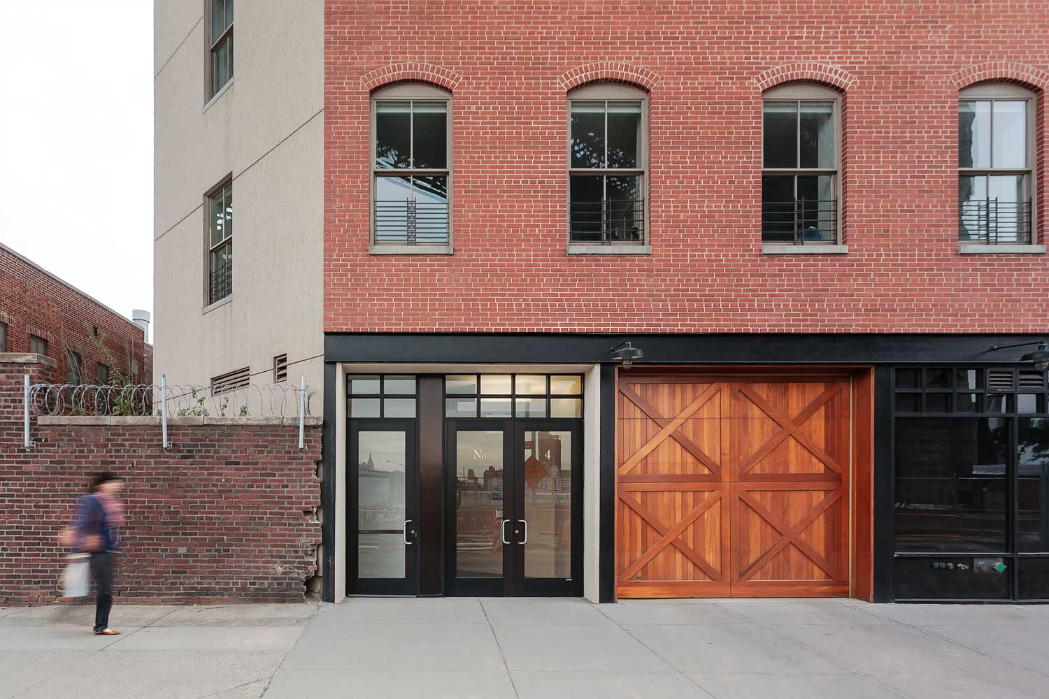 Condominium and garage entry to this historic rebuild and expansion by OCV Architects.