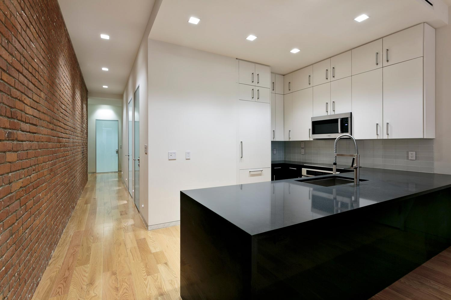 Open kitchen at this residential loft renovation in Tribeca. Project by OCV Architects.