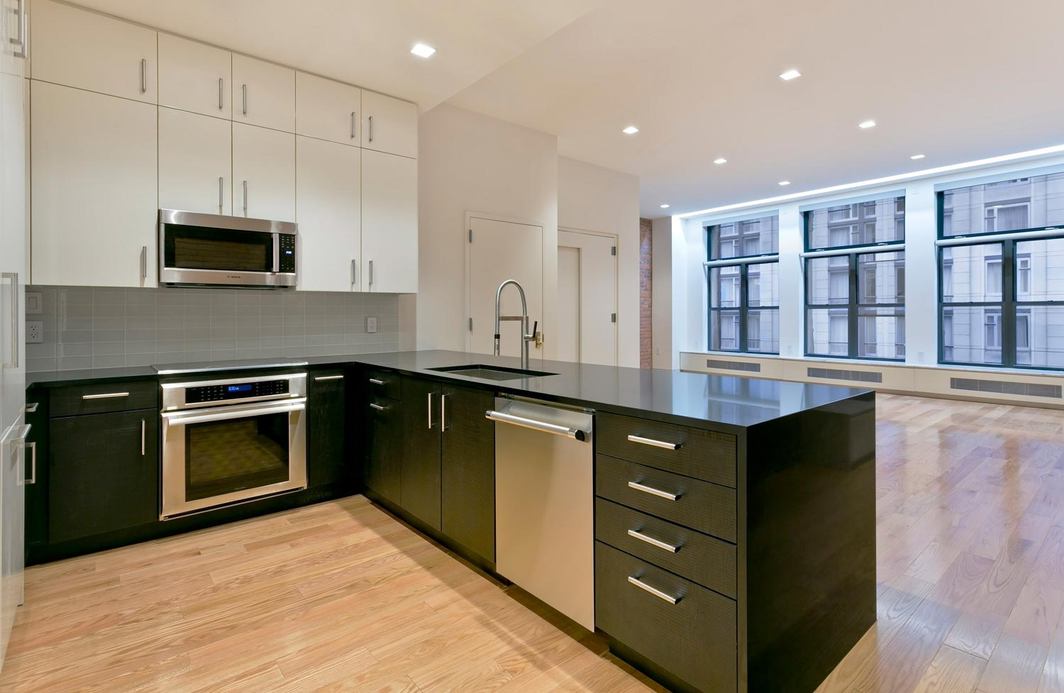 The open kitchen-living room at this West Broadway loft renovation by OCV Architects.