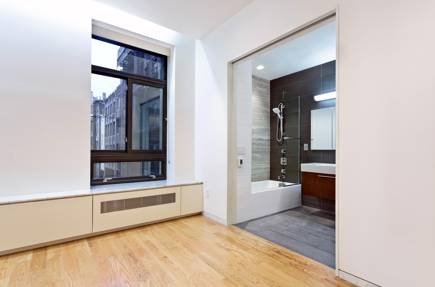 Strategic new window opening offer views of both the street and authentic west facing alley.