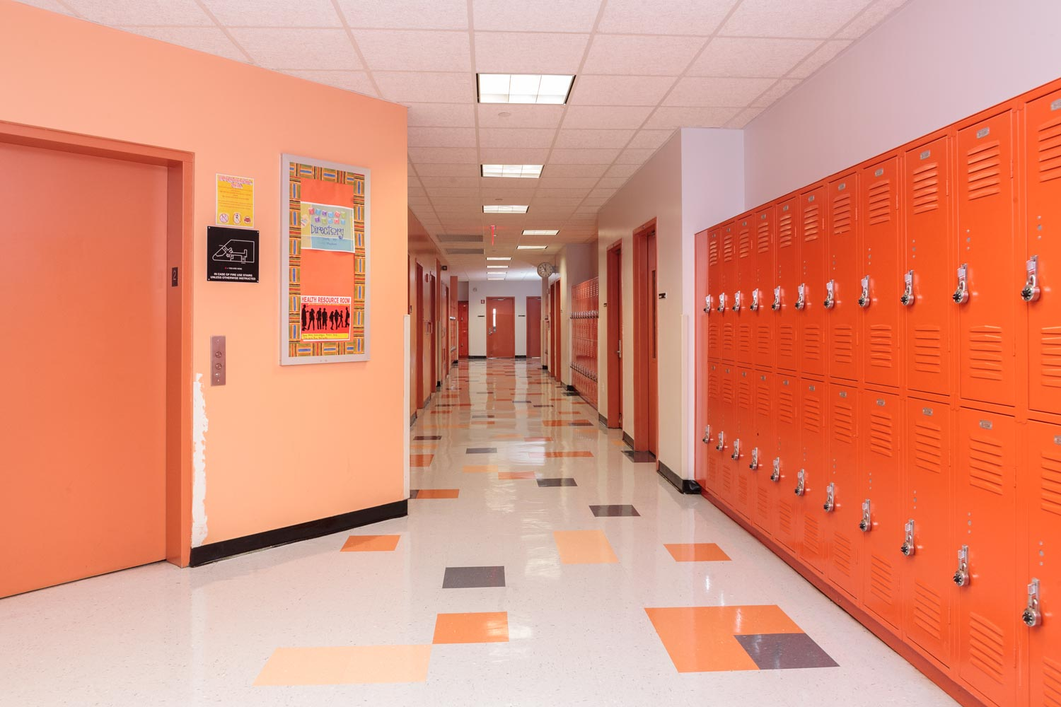 In corridors and classrooms, color is used as a device to designate the different floors.