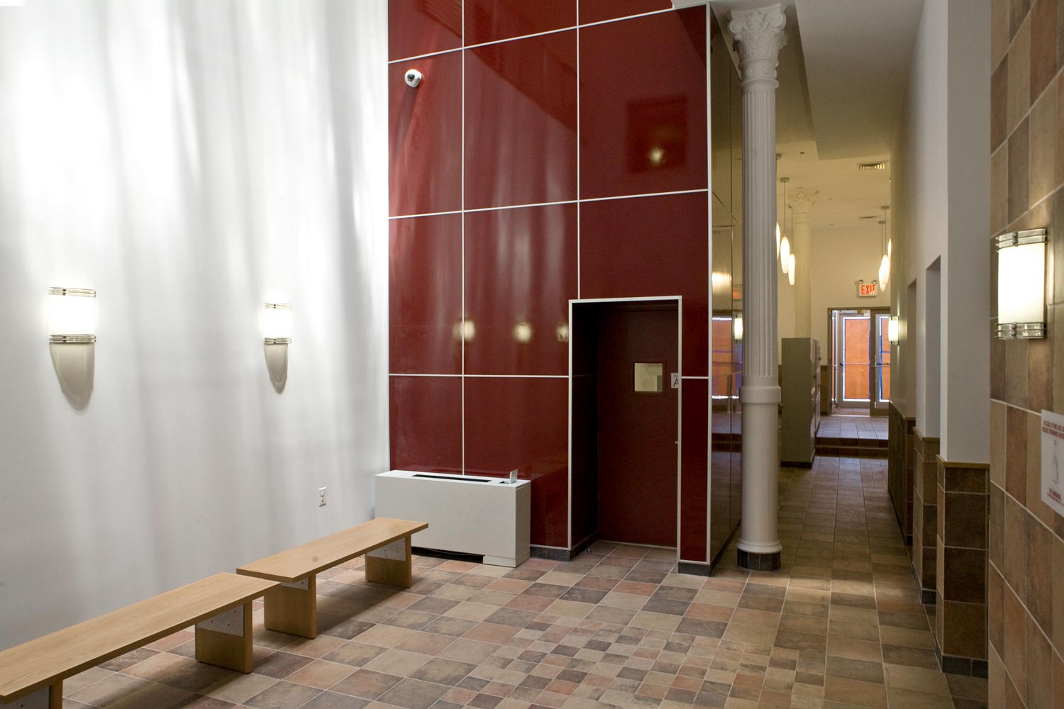 A skylight brings natural light down into the otherwise dark central elevator lobby.