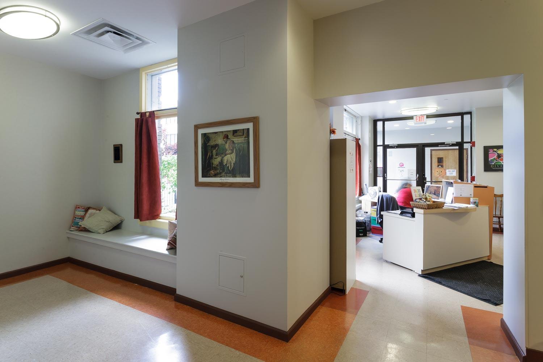 Window boards double as cozy sitting areas in the foyer of the Binghamton YWCA.