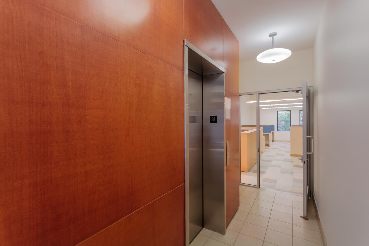 Elevator lobby at the administrative offices of the non-profit BronxWorks, by OCV Architects.