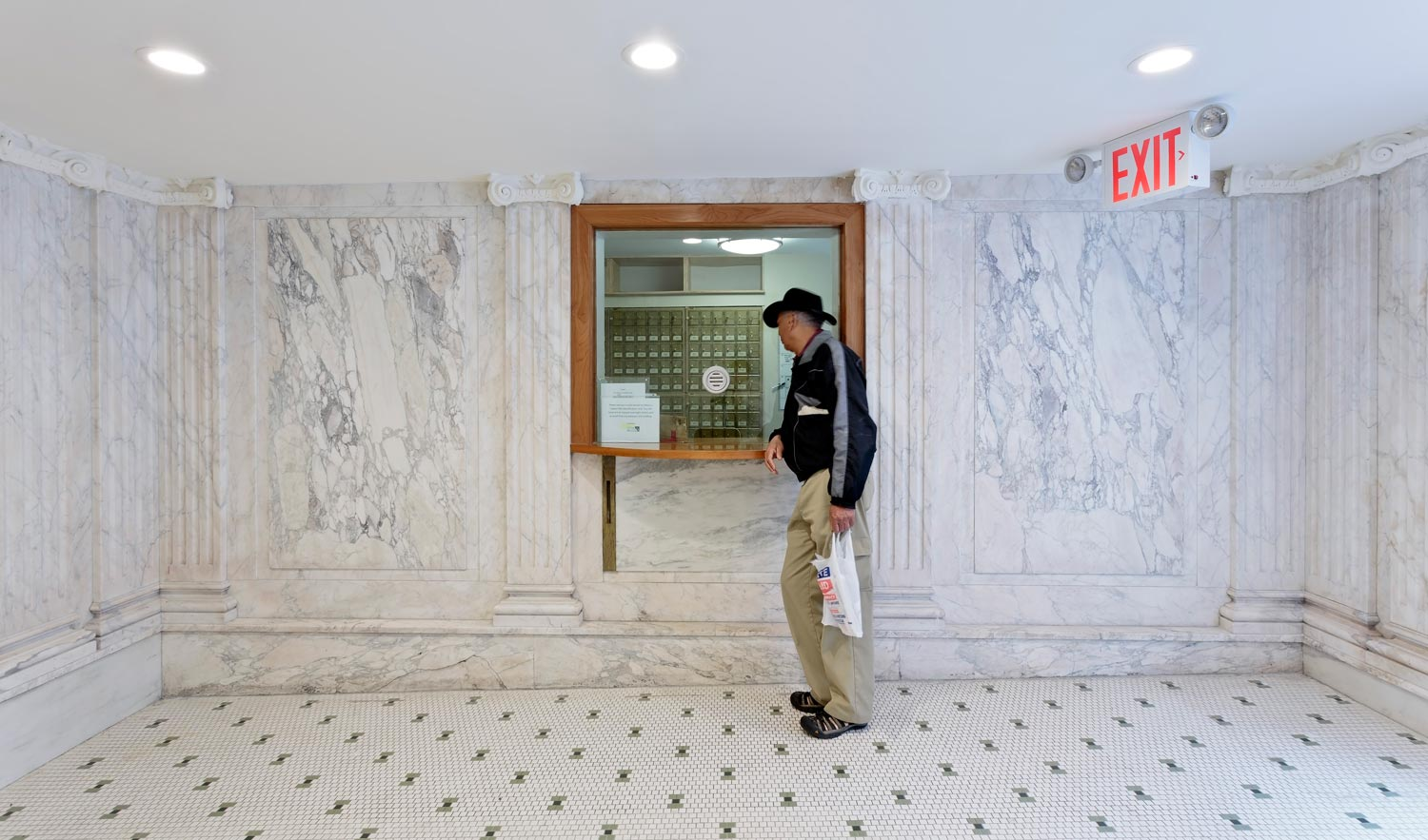 The marble clad vestibule at Capitol Hall, an award-winning tenant-in-occupancy rehabilitation and reconfiguration by OCV Architects.