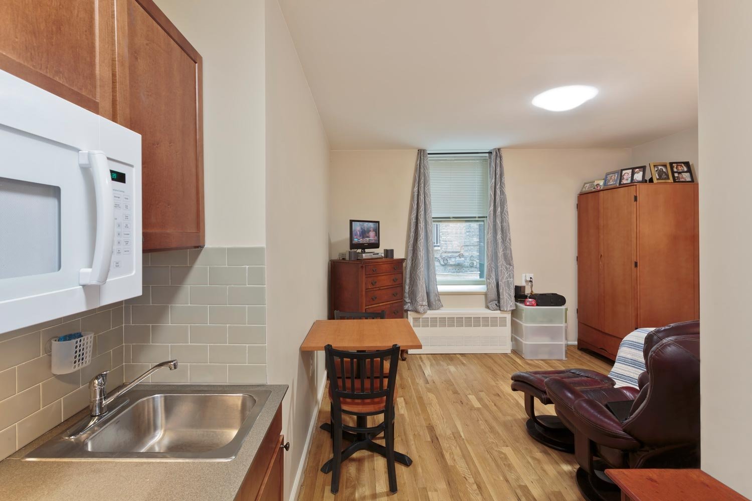 Existing arrangements of shared bathrooms and kitchens was reconfigured to units with private kitchenettes and bathrooms.
