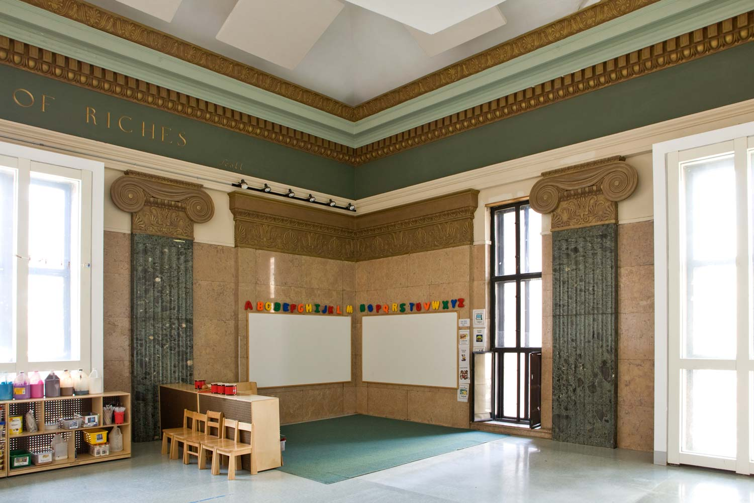 A new multi-level school in a vaulted former banking hall. Project by OCV Architects.