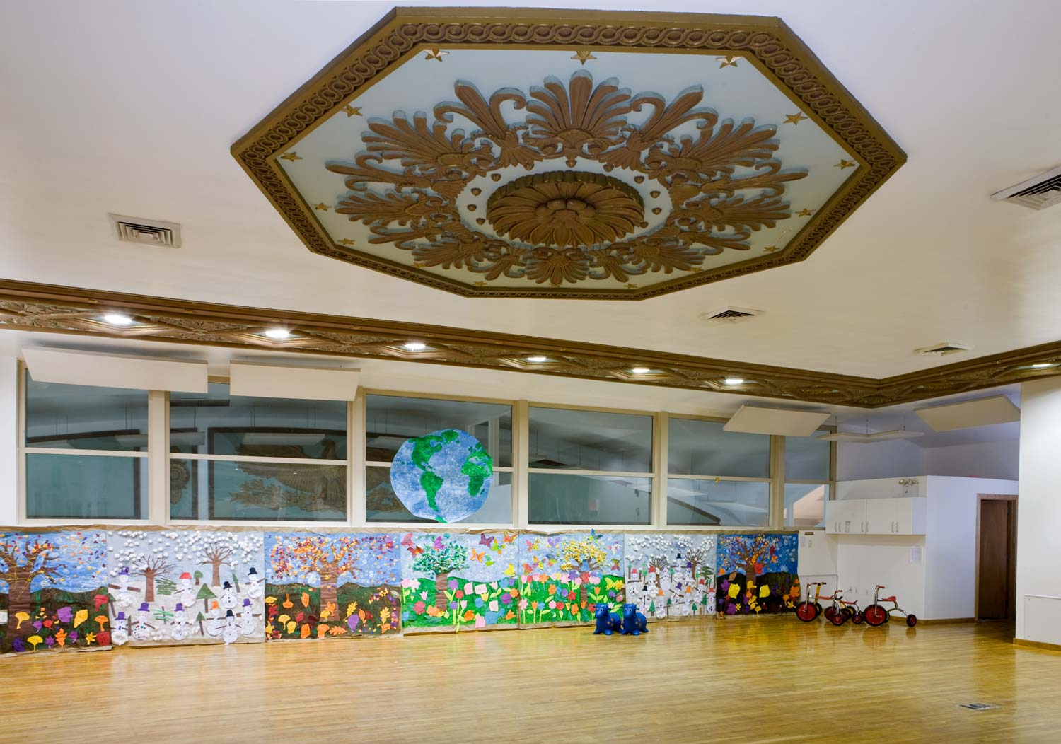 Ornate ceiling details decorated the indoor play space at the school. Project by OCV Architects.