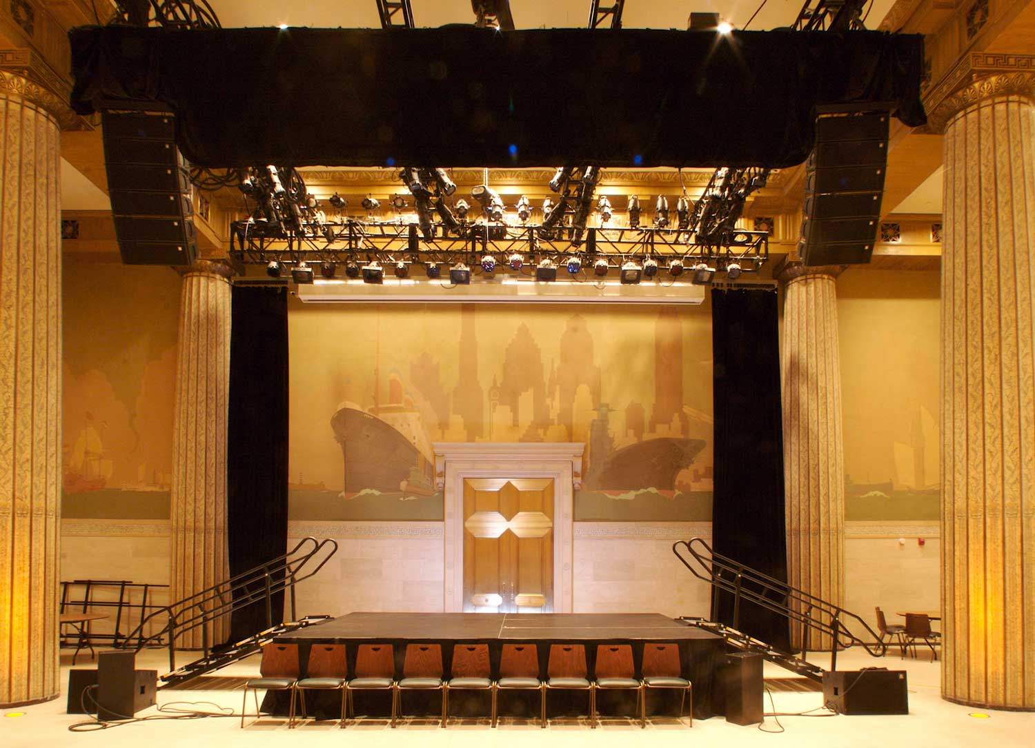 The grand banking hall was restored and converted into a striking auditorium. Project by OCV Architects.