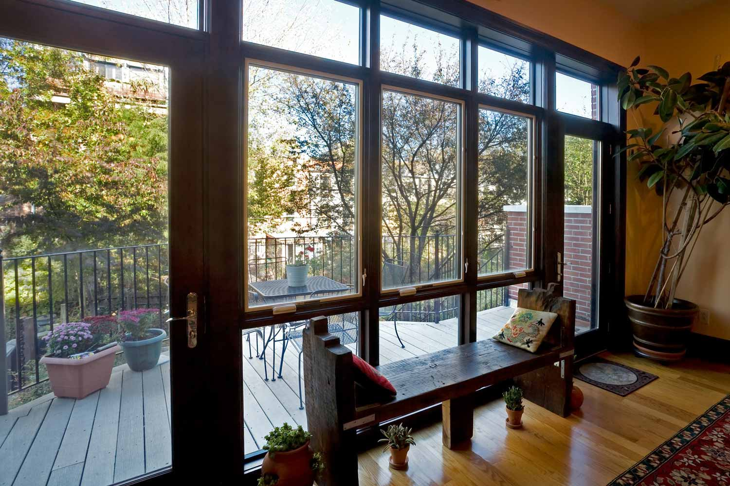 Expansion of the residence's rear resulted in a grand room giving way to a terrace.