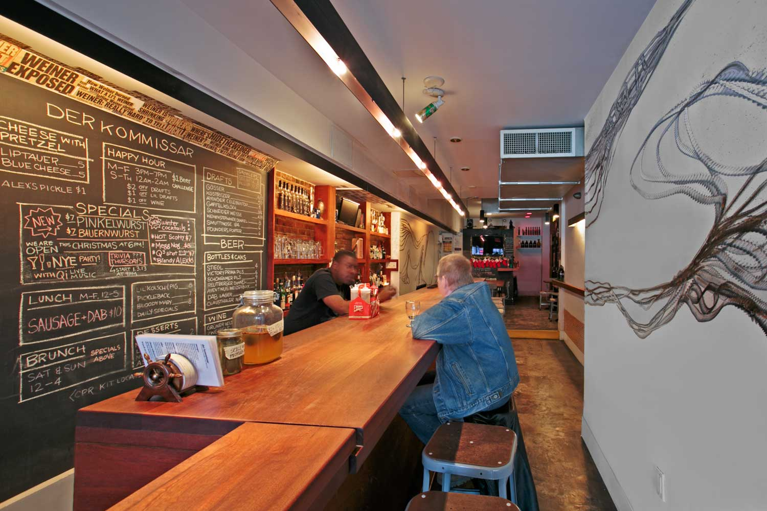OCV Architects used above-head lighting to run the length of the bar.