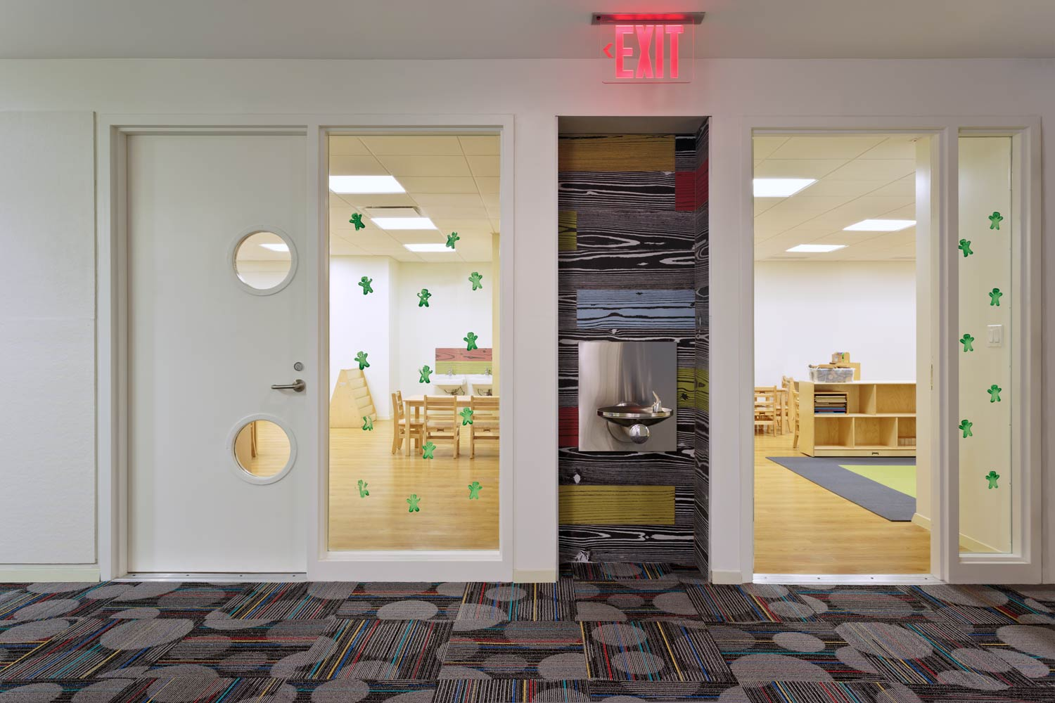 Interior glazing brings natural light into inner corridors and creates a visual connection to the classrooms.