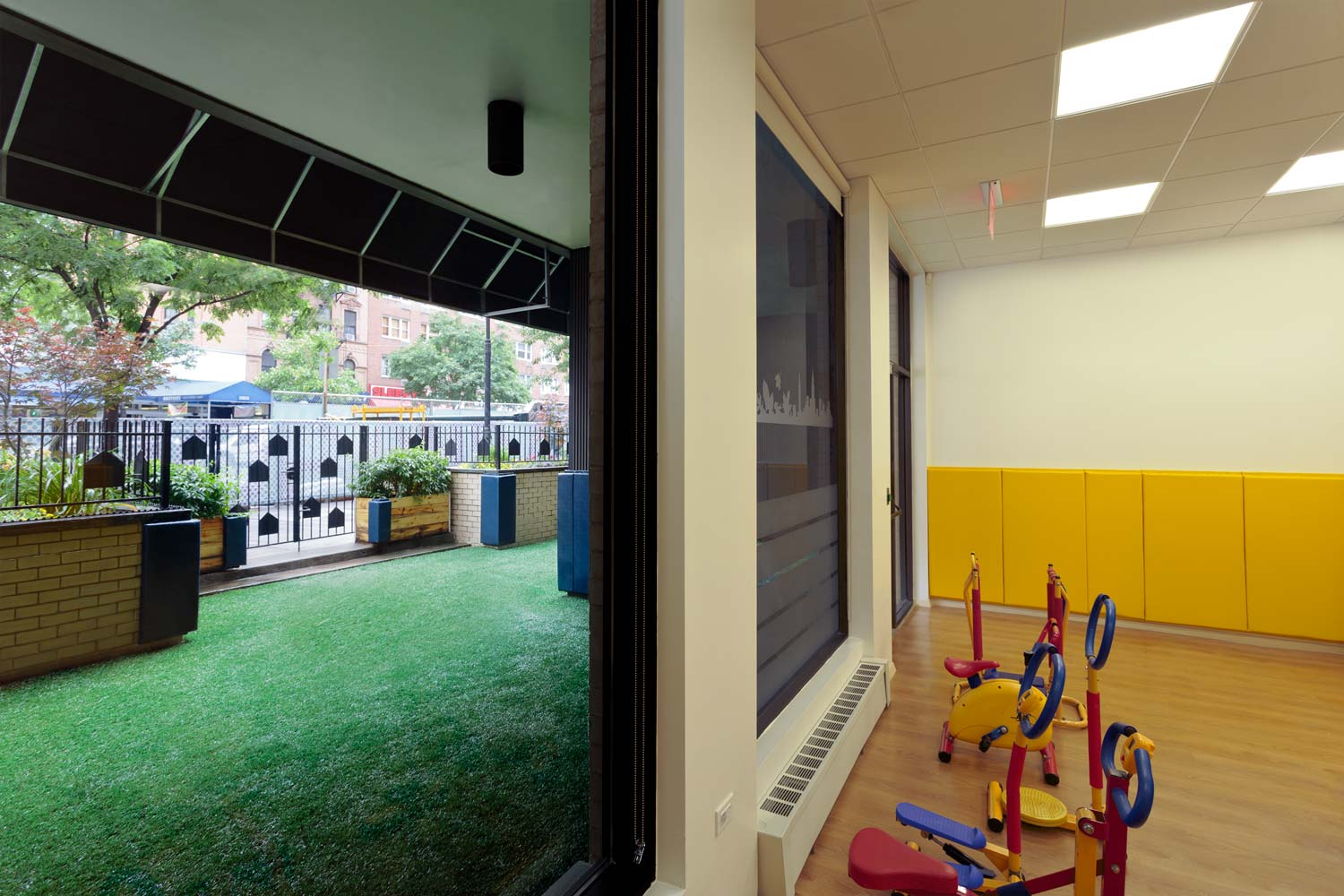 The International Preschools playroom with access to an outdoor area.