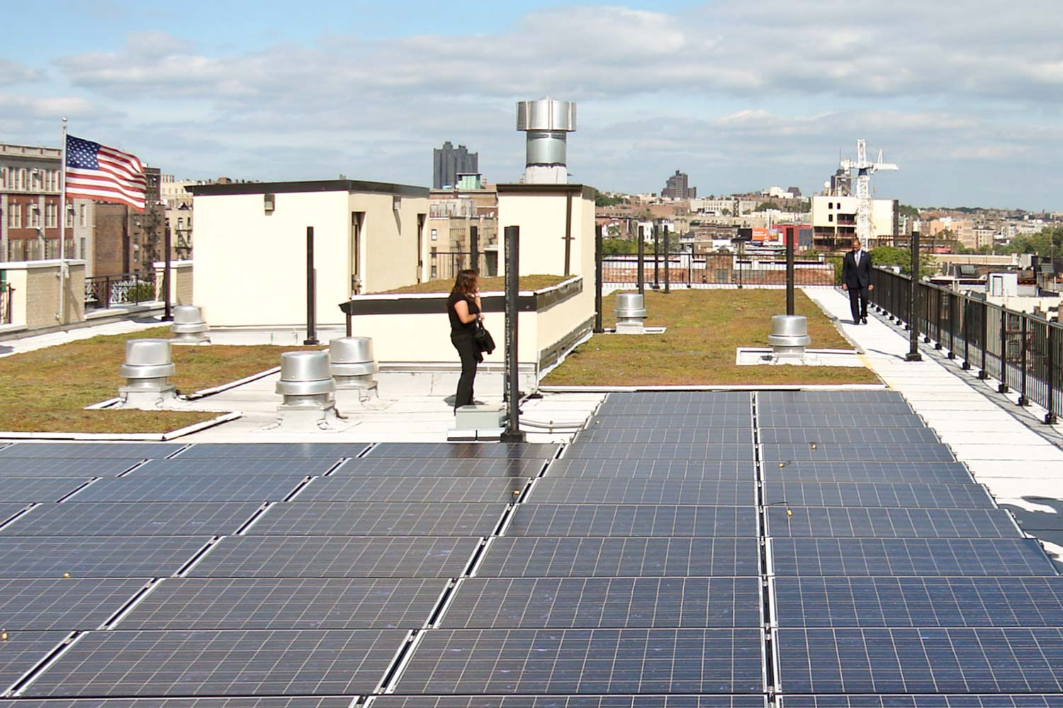 The rooftop harvests rain water and photovoltaic panels produce electricity for lighting public halls.