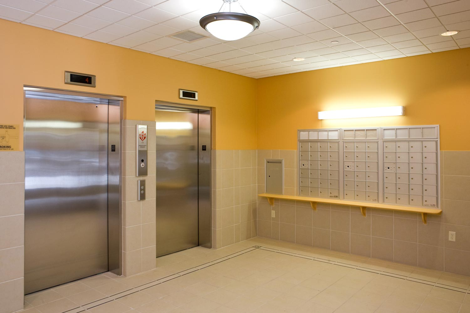 The elevator lobby and mail room at Jacob's Place Apartments in the Bronx.