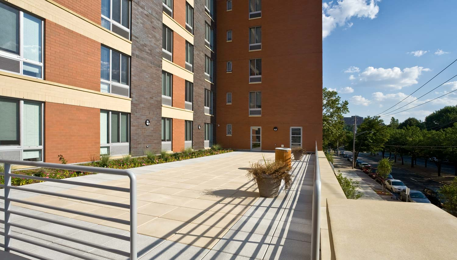 The second floor terrace is one of several rooftop terraces accessible for residents' use.