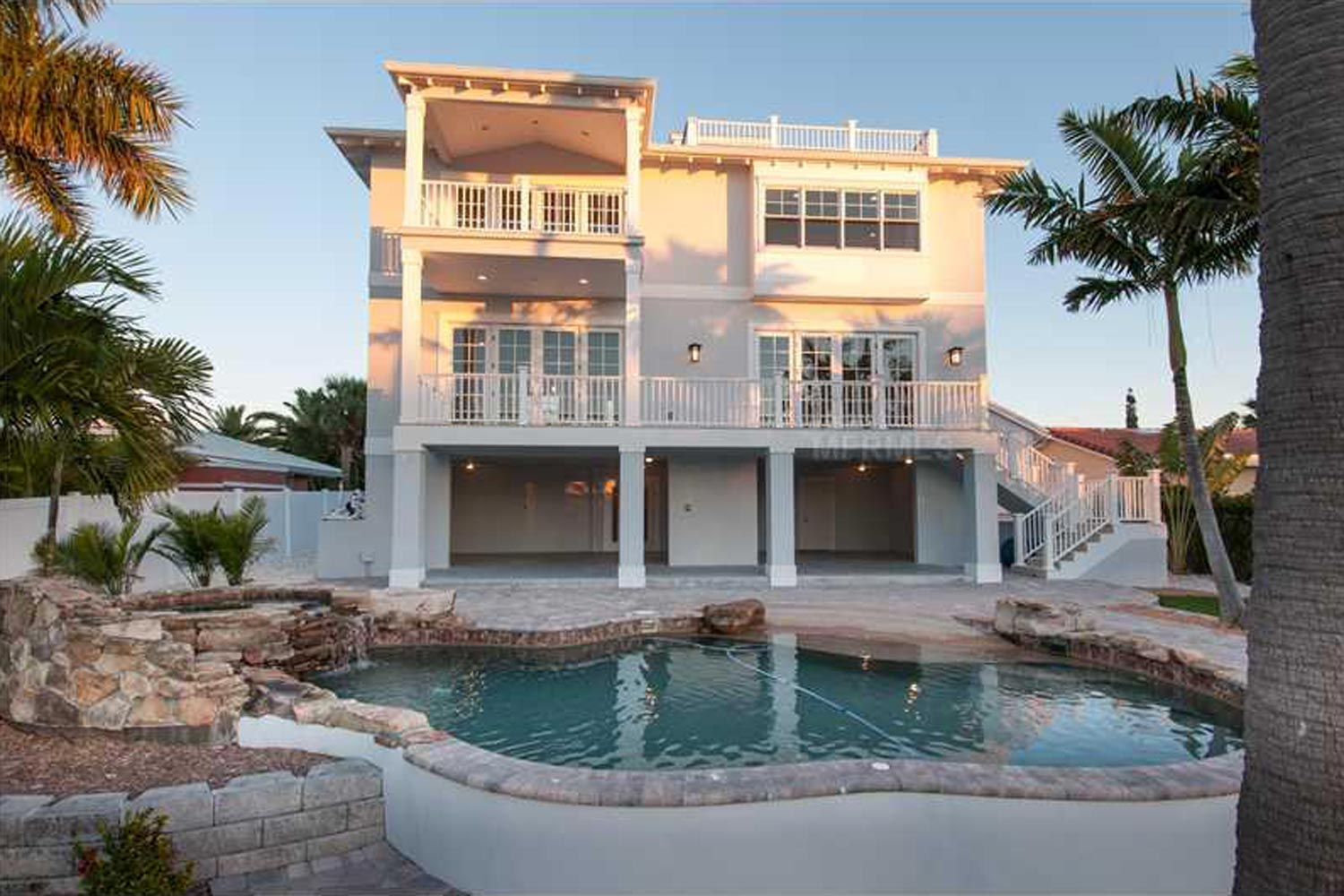 Three level beach house located on a canal off the Gulf of Mexico in St. Pete Beach.