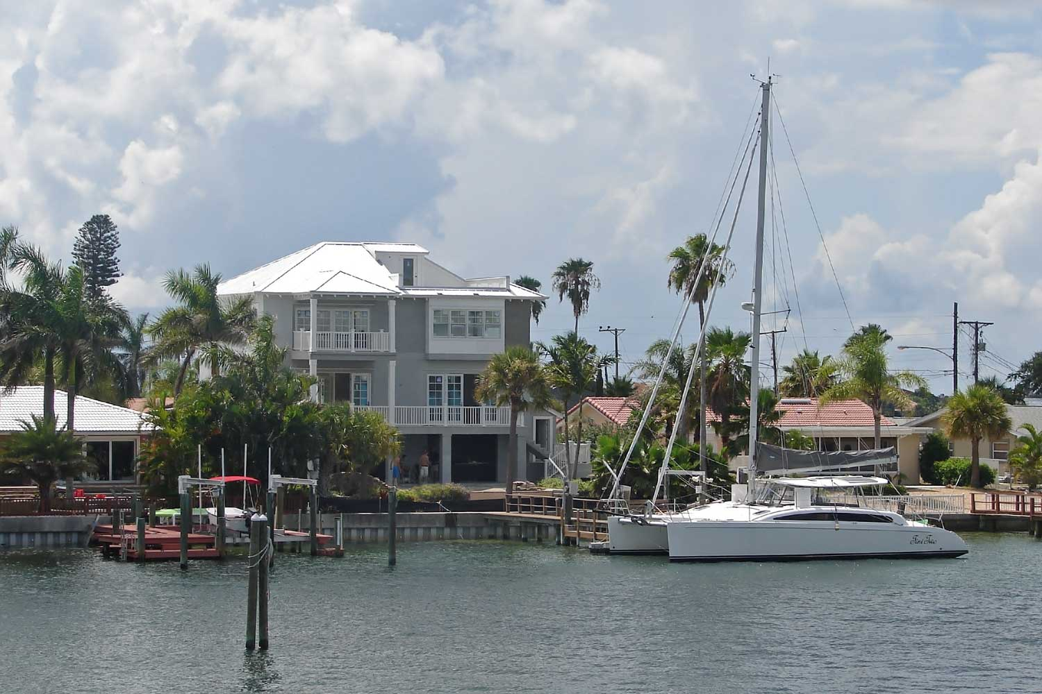 This three level beach residence is located on a canal off the Gulf of Mexico.