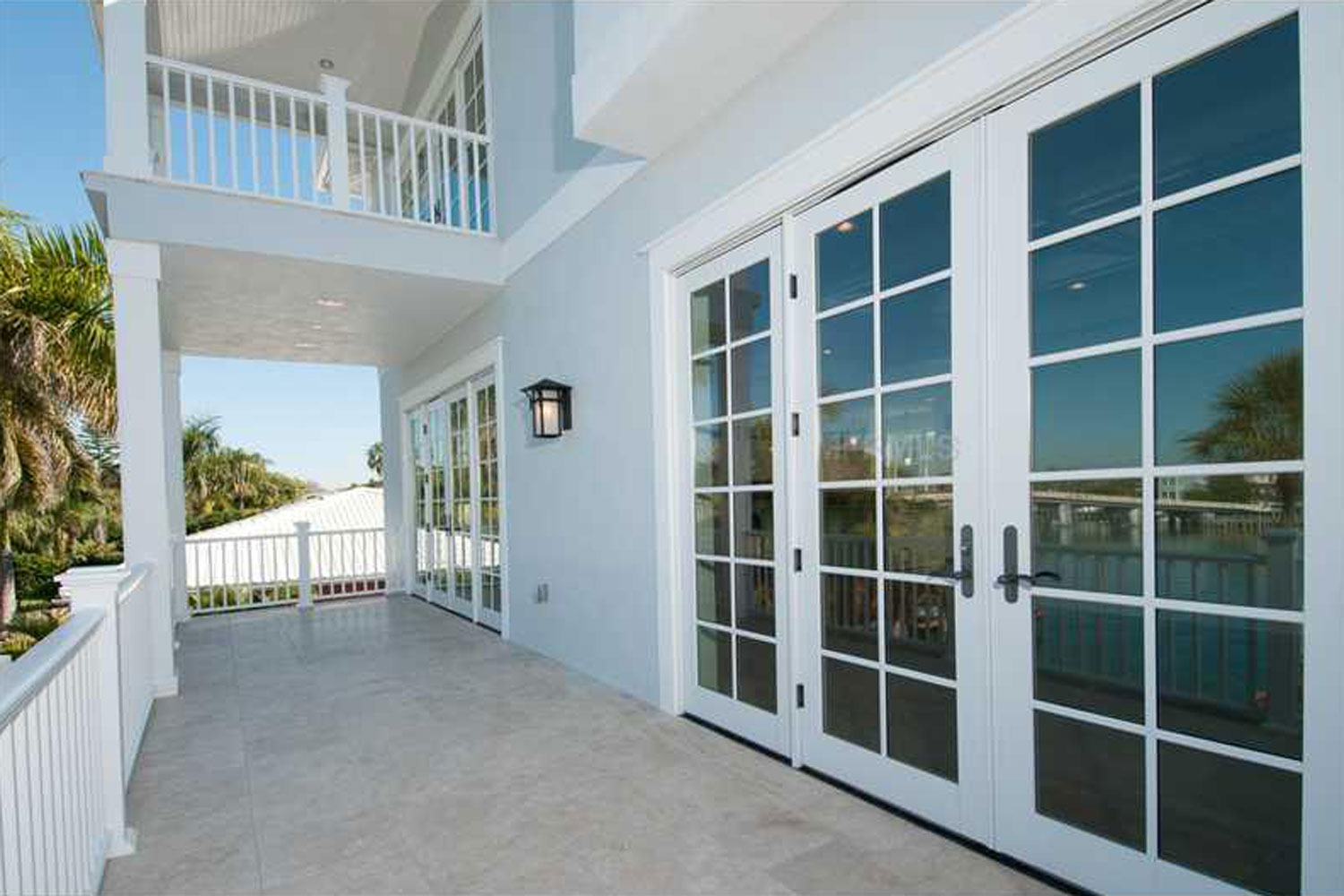 Generous decks on the upper floors and roof take advantage of sunset views over the Gulf.