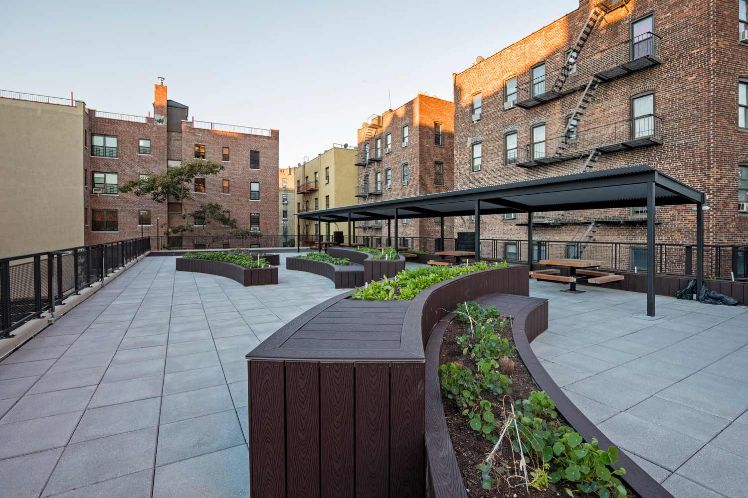 Gardening planters for resident use transform this affordable housing building into a community asset.