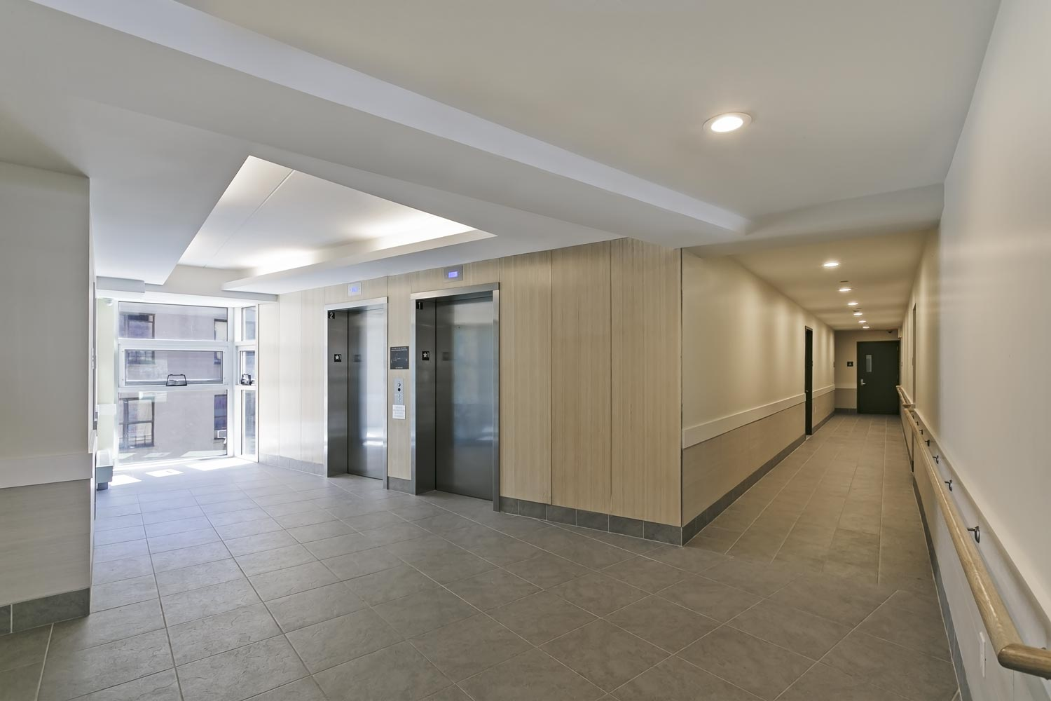 The elevator lobby features a curtain wall looking down on the rear yard and terrace.