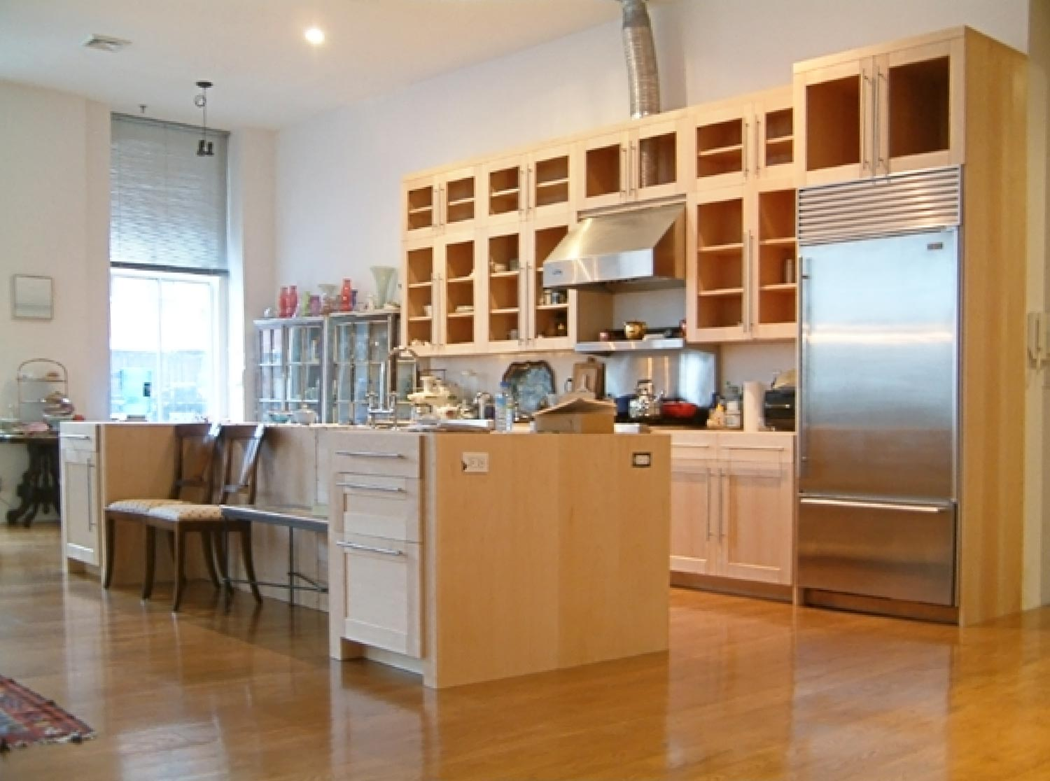 The open kitchen is off the living room at this Tribeca loft project by OCV Architects.