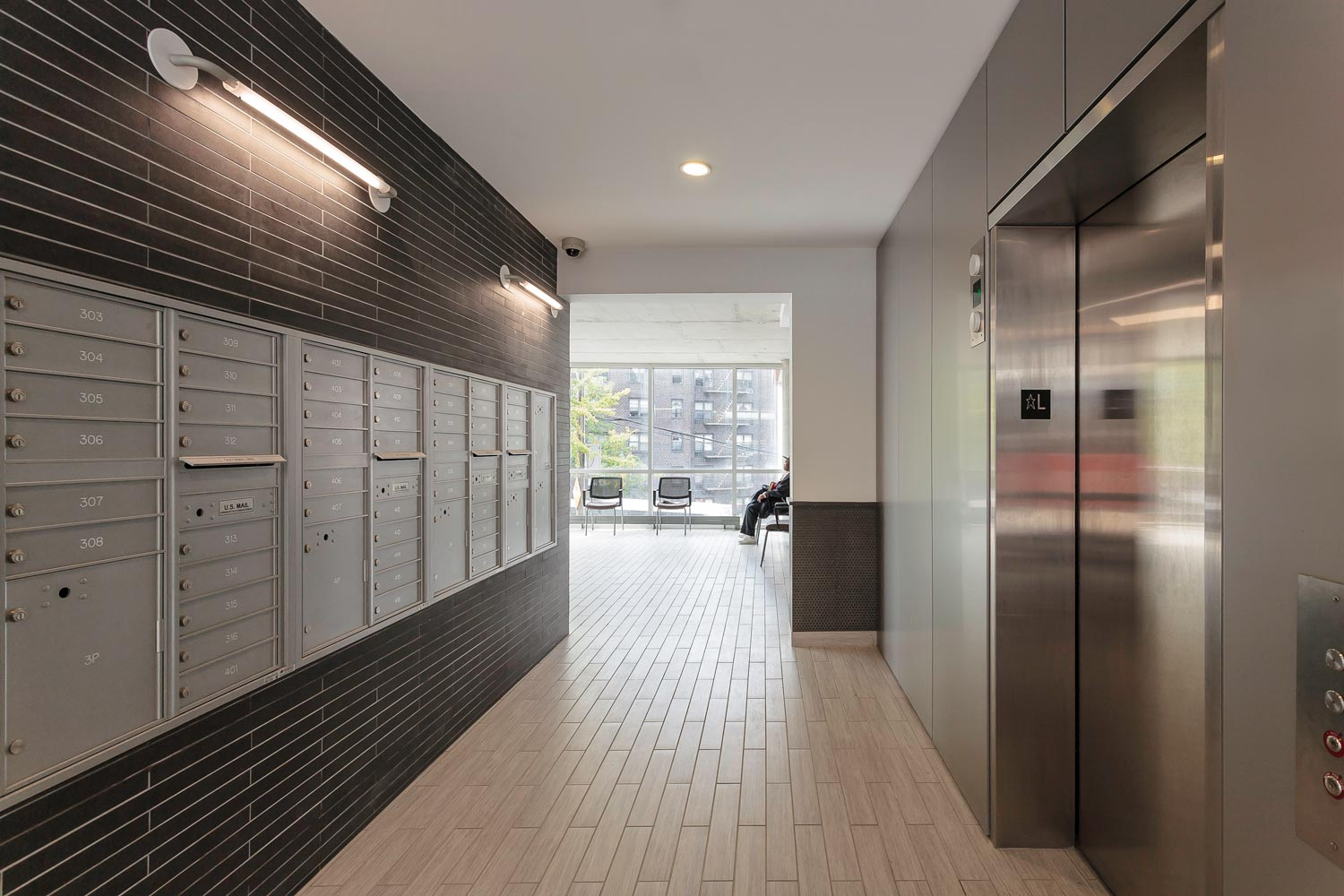 The lobby at Kingsbridge Terrace offer expansive views with mailboxes tucked away across from elevators.