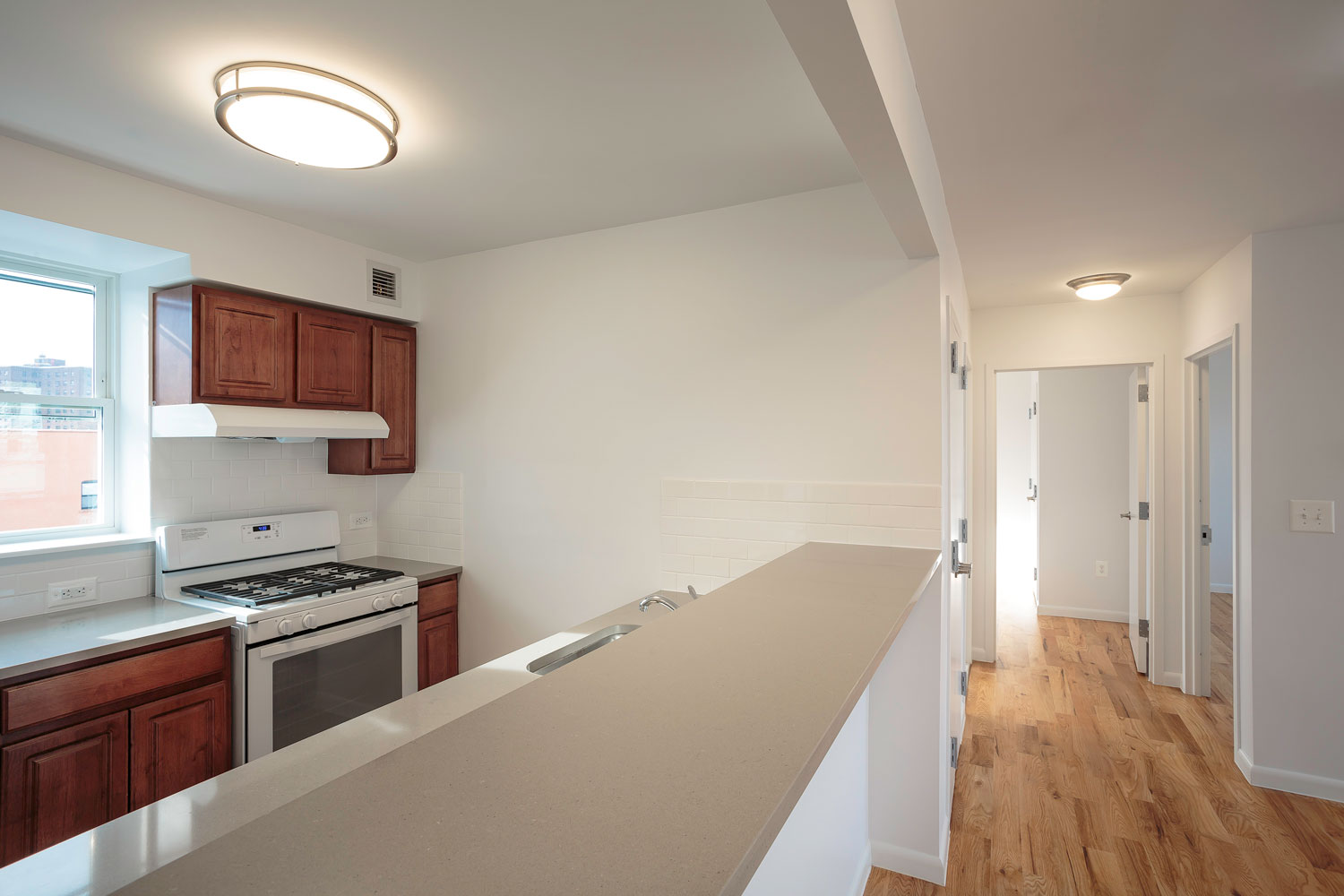 Open kitchens at these green, affordable condos designed by OCV Architects for Habitat for Humanity - NYC.