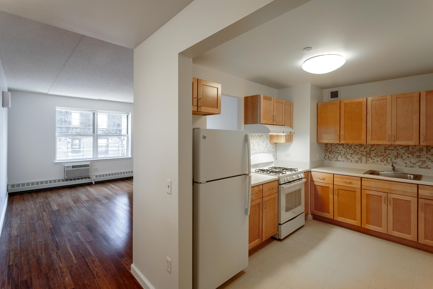 Open kitchens, sustainable materials, efficient lighting, fixtures and appliances in Tiebout Green affordable apartments.