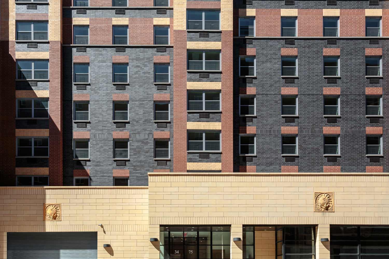 The tricolor facade of Casa del Mundo plays off of neighboring buildings.