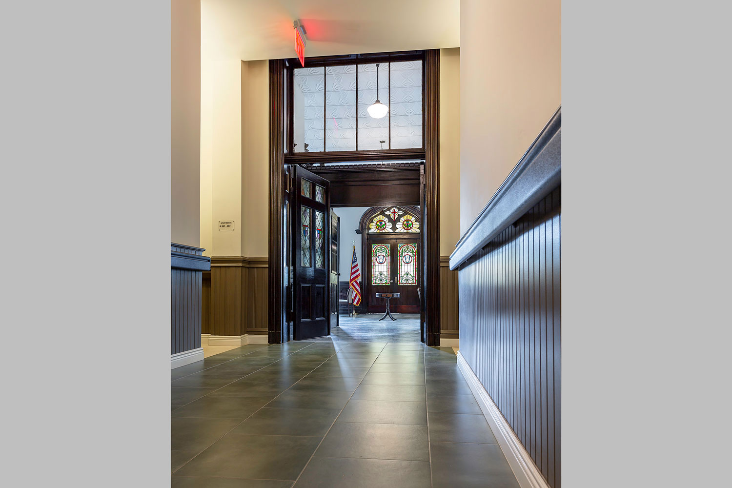 Hallway leading into the community room at Serviam Heights Senior Apartments
