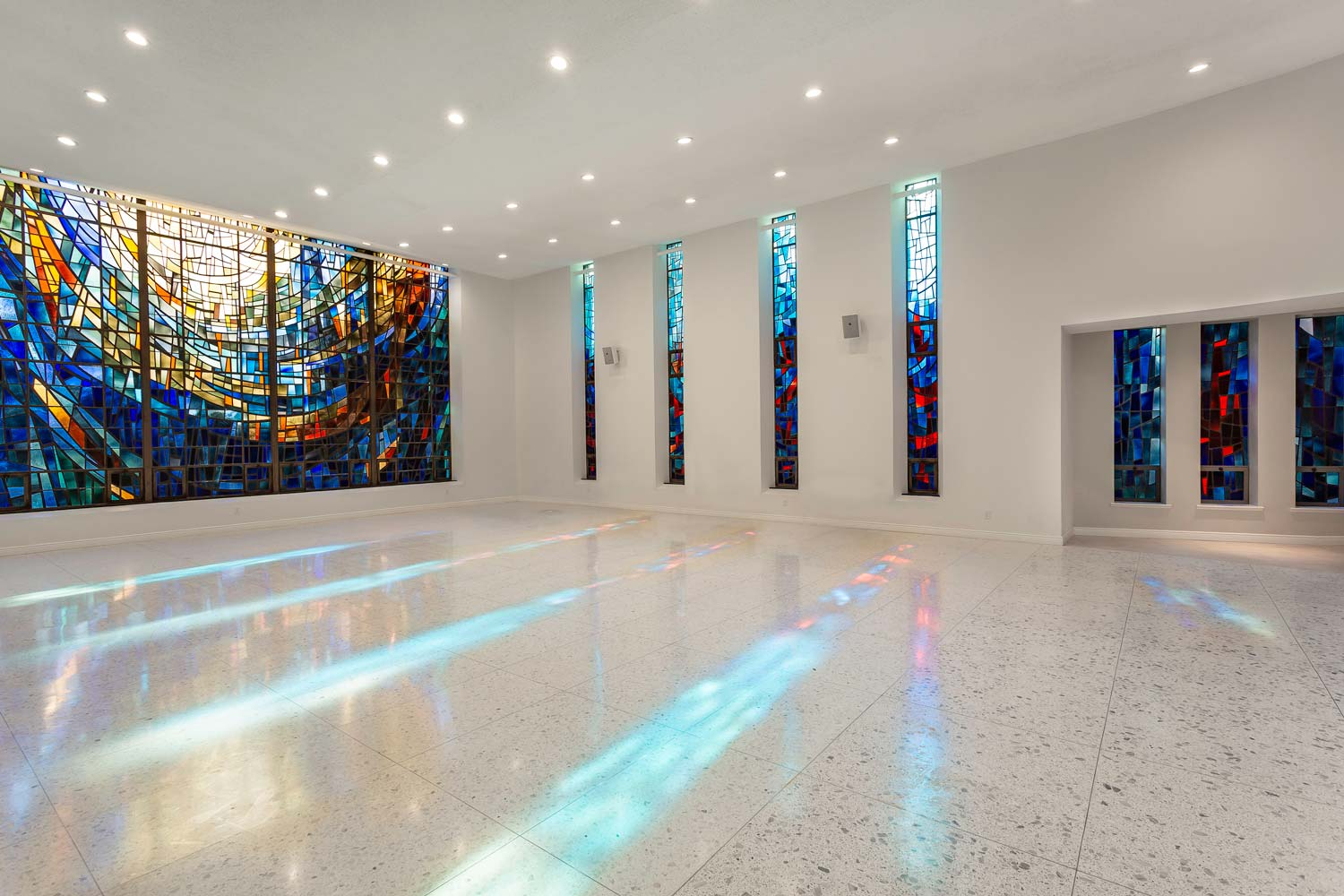 Part of the work restored the beautiful, modern, stained glass windows of the chapel at Serviam Heights.