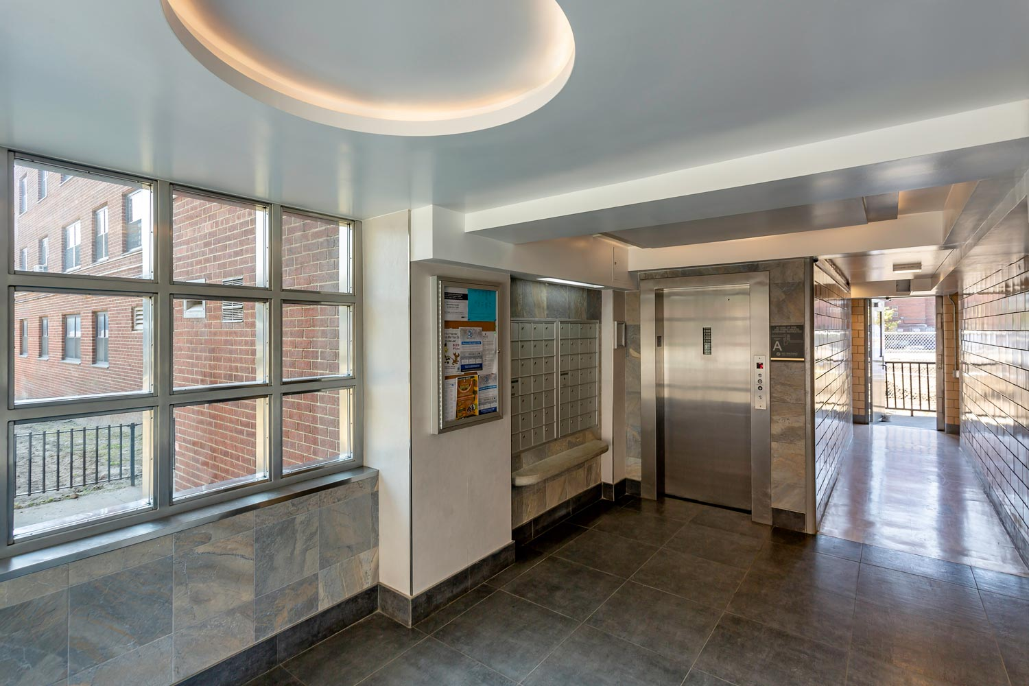 OCV introduced new finishes and high efficiency lighting into public halls at Ocean Bay-Bayside Apartments.
