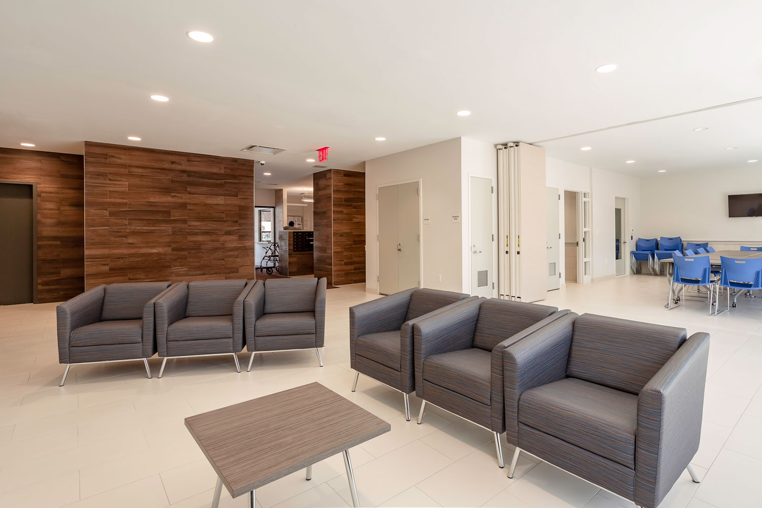 A folding wall expands the lobby lounge for community gatherings and events.