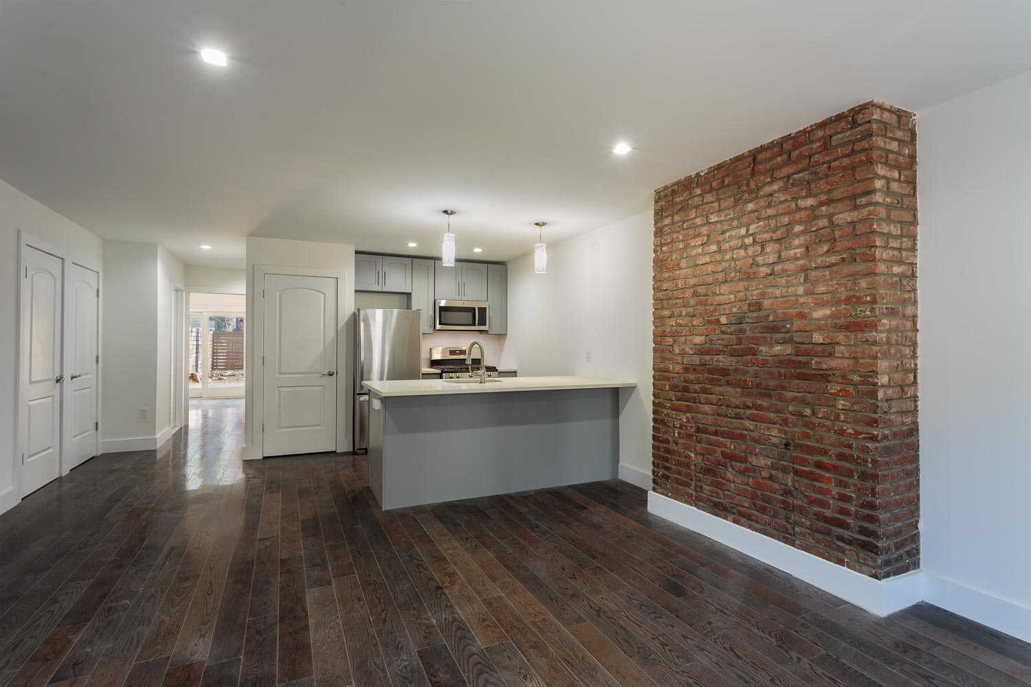 Former fireplaces were left intact and refinished as wall accents at this townhouse renovation