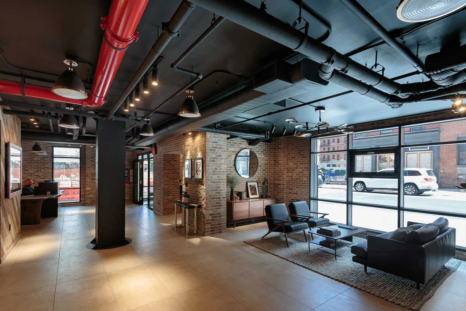 Cozy, cove-like lounge with exposed brick and real wood finish at Ponte Residences Tribeca