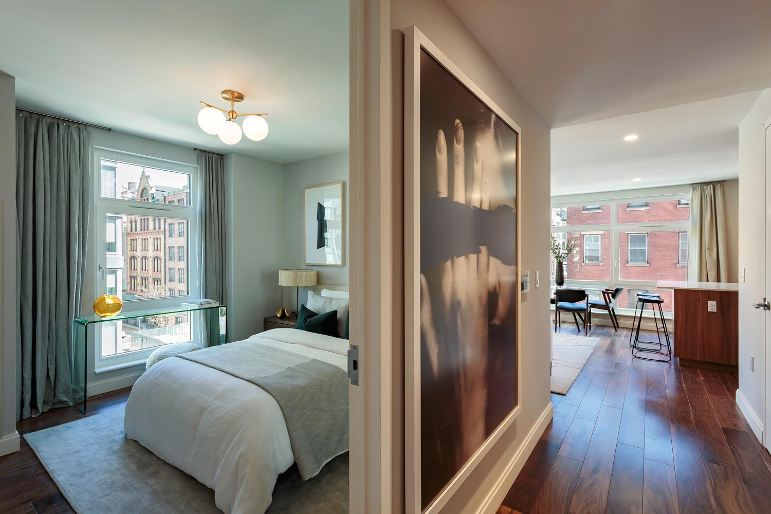 Bedroom with view into open kitchen at Ponte Residences, 440 Washington in Tribeca