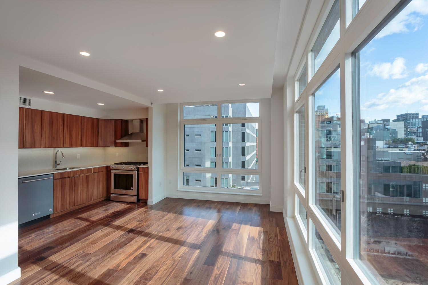 Open kitchen-living rooms and floor-to-ceiling windows at Ponte Residences, 440 Washington Street in Tribeca