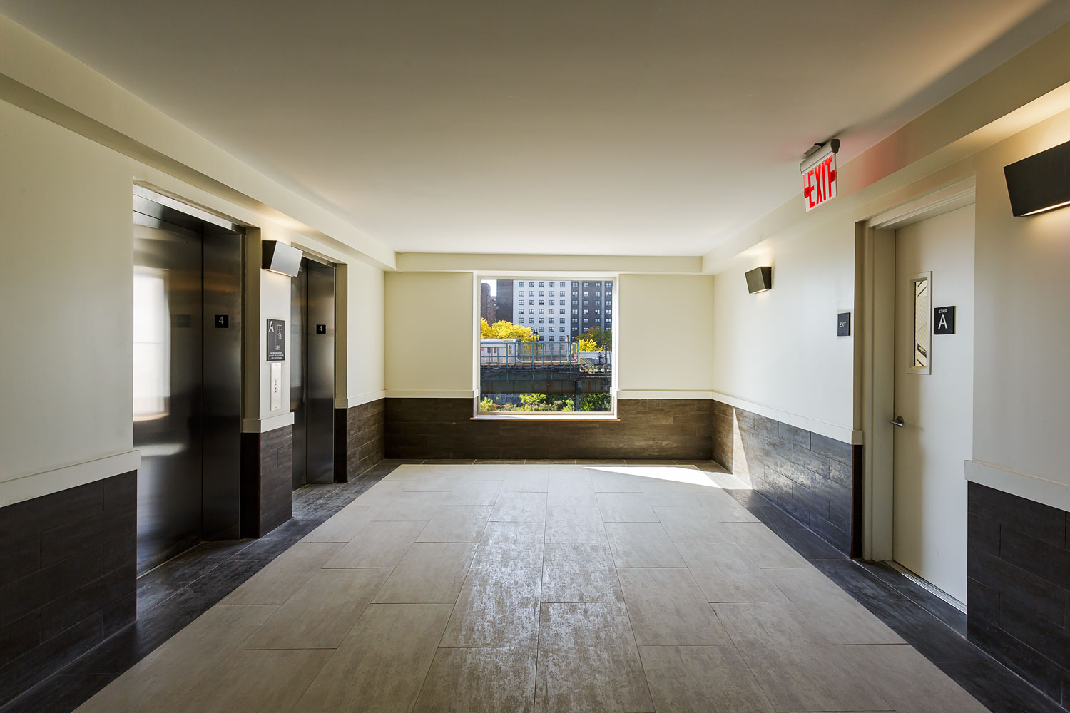 Elevator lobbies on each floor of Beverly's Place feature a large picture window