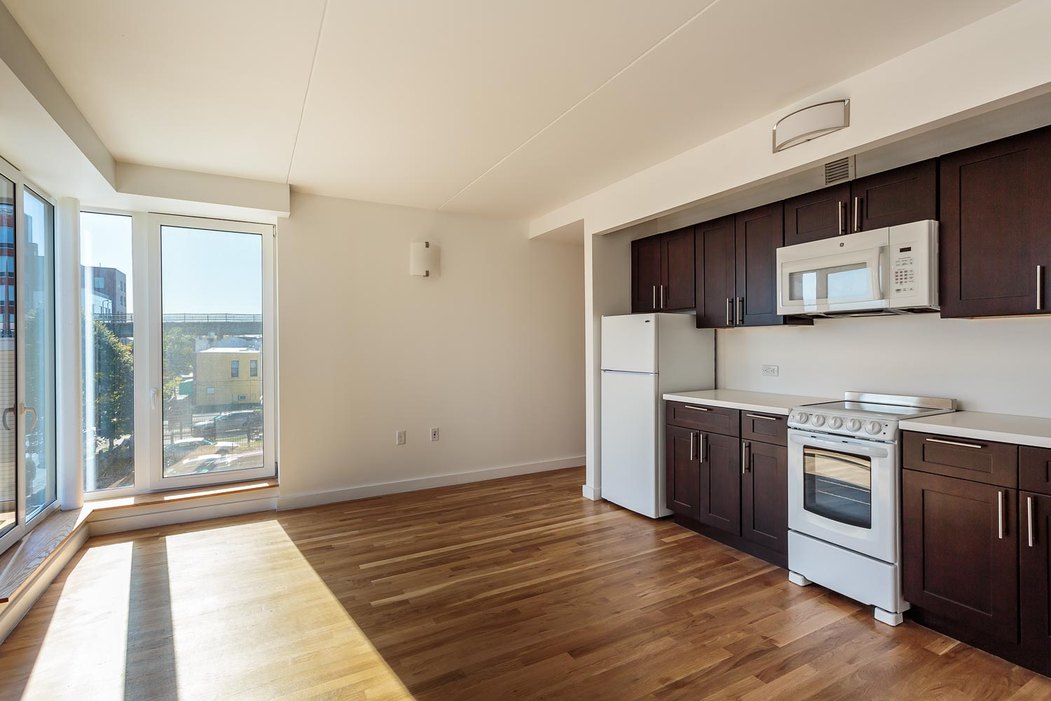 All units at Beverly's Place are designed with floor to ceiling fenestration and full kitchens